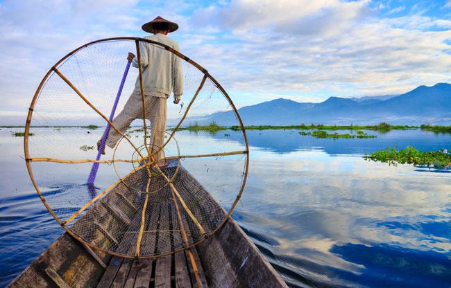 Fishermen in Inle Lake at sunrise, Shan State, Myanmar.