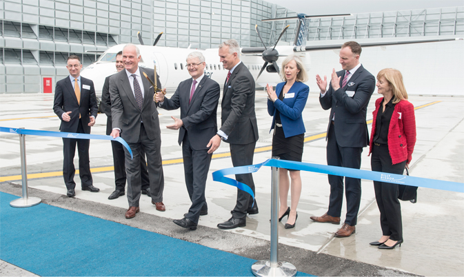 he Honourable Marc Garneau, Minister of Transport joins PortsToronto CEO Geoffrey Wilson and PortsToronto Chair Robert Poirier to cut the ribbon to officially open the new Ground Run-Up Enclosure at Billy Bishop Toronto City Airport.