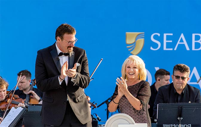 Seabourn Ovation godmother Elaine Paige gets a special bridge tour from the ship's Captain, Stig Betten (left), and Staff Captain, Stefan Tsvetkov.