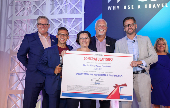 Nexion Canada travel agent wins Carnival cruise at WUATA party